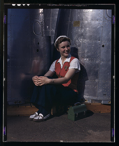 A noontime rest for a full-fledged assembly worker at the Long Beach, Calif., plant of Douglas Aircraft Company. Nacelle parts for a heavy bomber form the background - Flickr